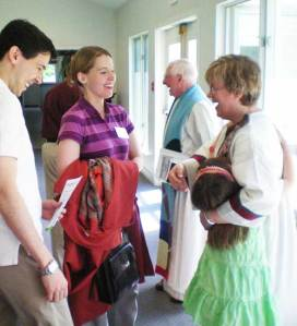 Rev. Diane Hoppe Hugo hugs her daughter Maggie while welcoming members of the community at her installation in July 2009.
