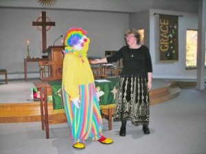 Rainbow sings with pastor